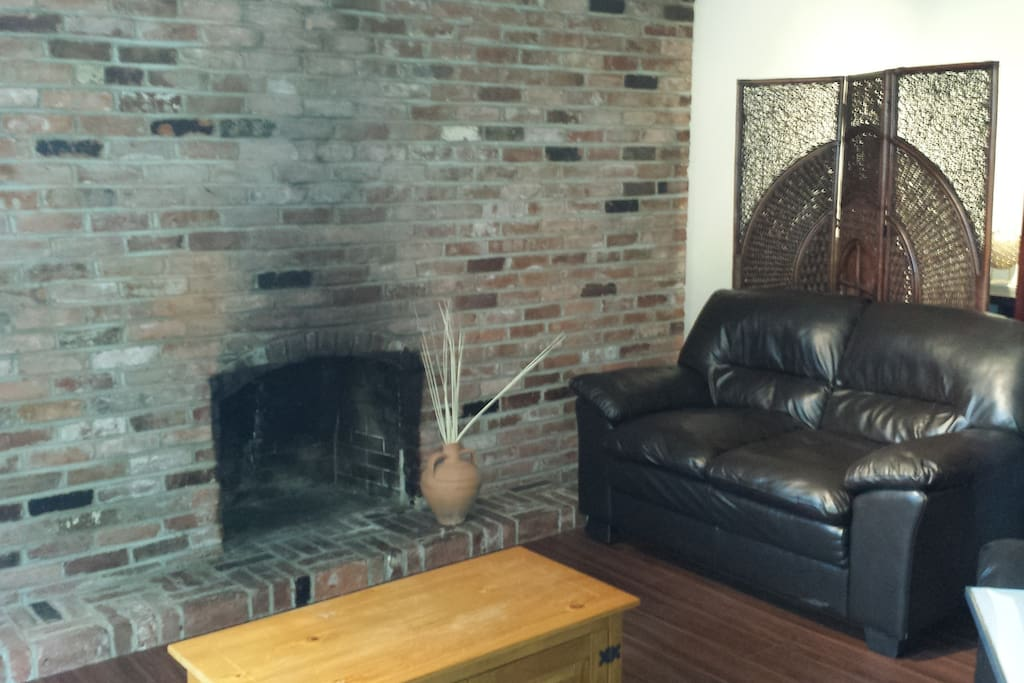 rustic brick fireplace in the living room