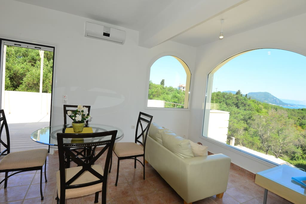 Spacious sitting and dining area with amazing views of the sea and surrounding countryside