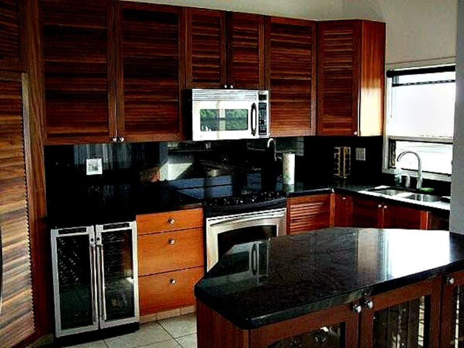 Another View of Kitchen with Black Granite Counters and African Mahogany Cabinets