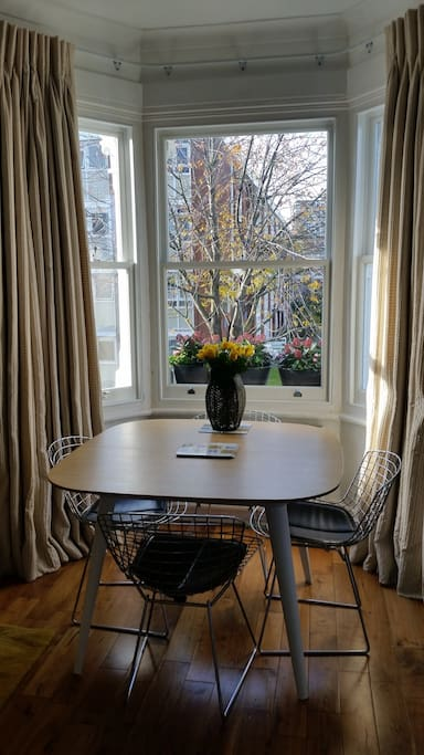 Beautiful, bright dining area with design table and chairs.