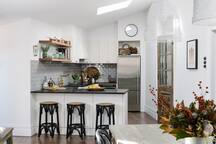 Fully equipped kitchen with a breakfast bar - glancing across from the dining area