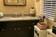This is the Guest Bathroom outside your bedroom in the Hall.