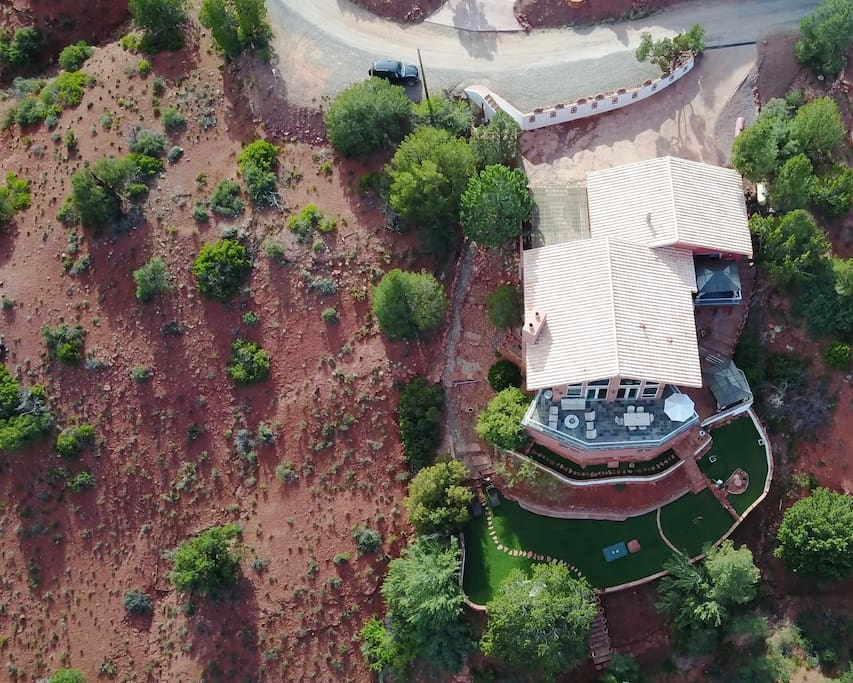 This is an ariel view of the property. Kokopelli studio lays to the back right hand side. If you look carefully you will see the cabana on the studio deck under the 2nd roof top