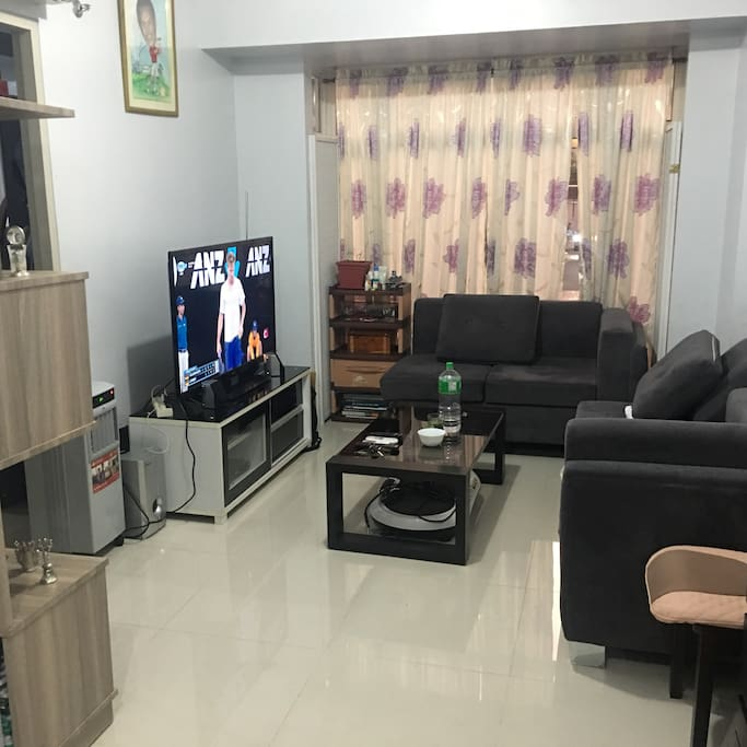 """Living room with 50"""" TV with Cignal Cable service."""