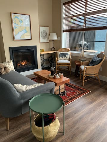 The living room features a cozy and warm gas fireplace.