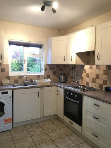 Fully equipped kitchen with cooker, washing machine, fridge freezer, toaster, microwave, and everything needed for self catering.
