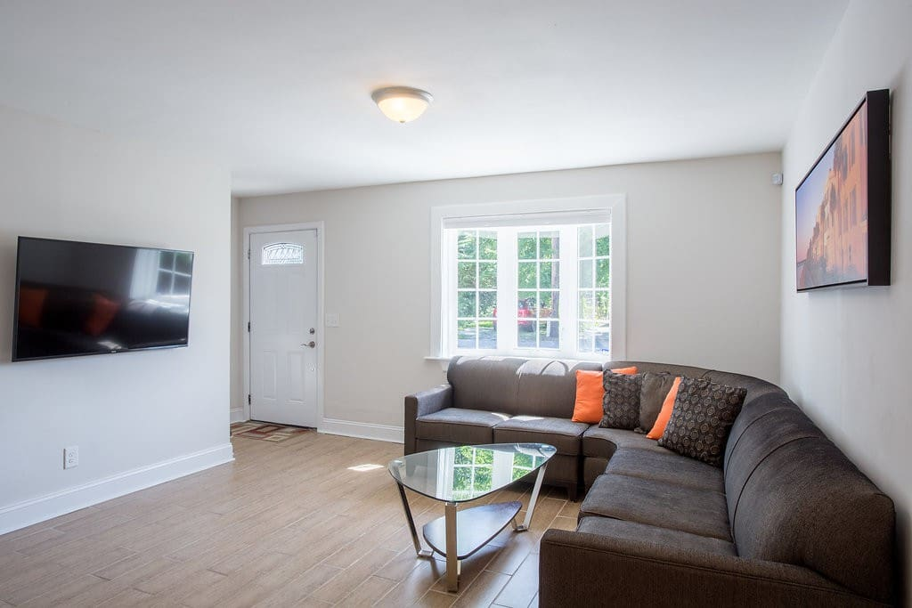 Spacious Living Room with Big-Screen 4K HD Television and Comfortable Seating