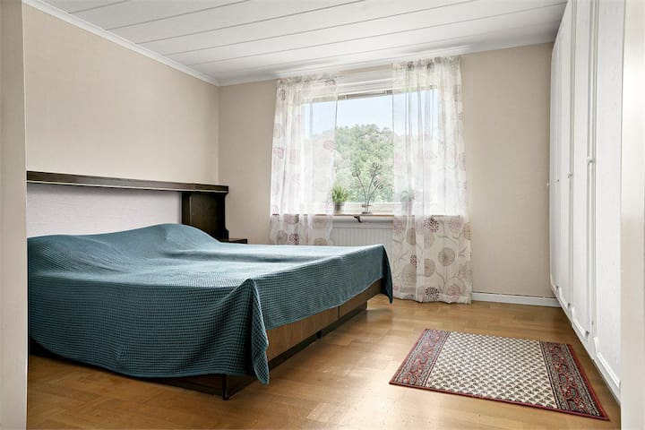 Double bed with with many closets on the first floor.