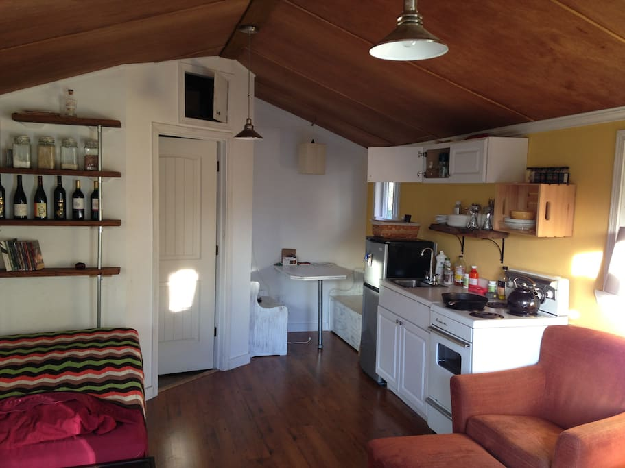 Small, fully functioning kitchen space with dining space for 4.