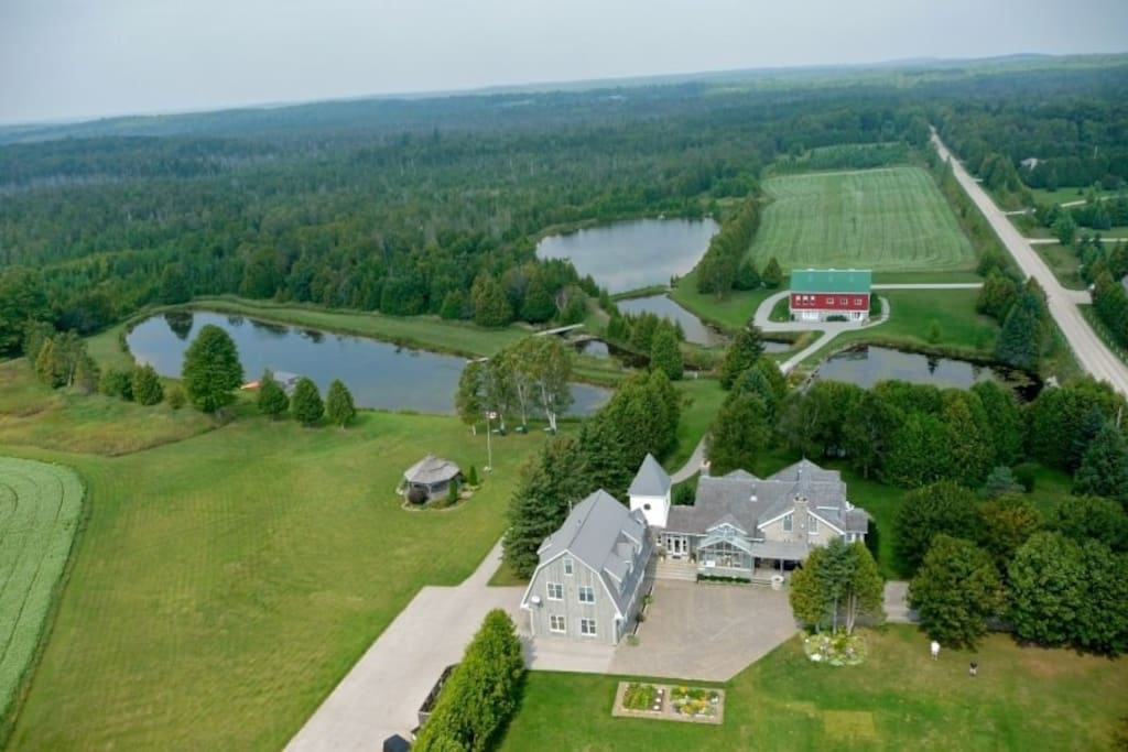 Aerial view of the entire property. Two ponds, Separate barn with accommodation.