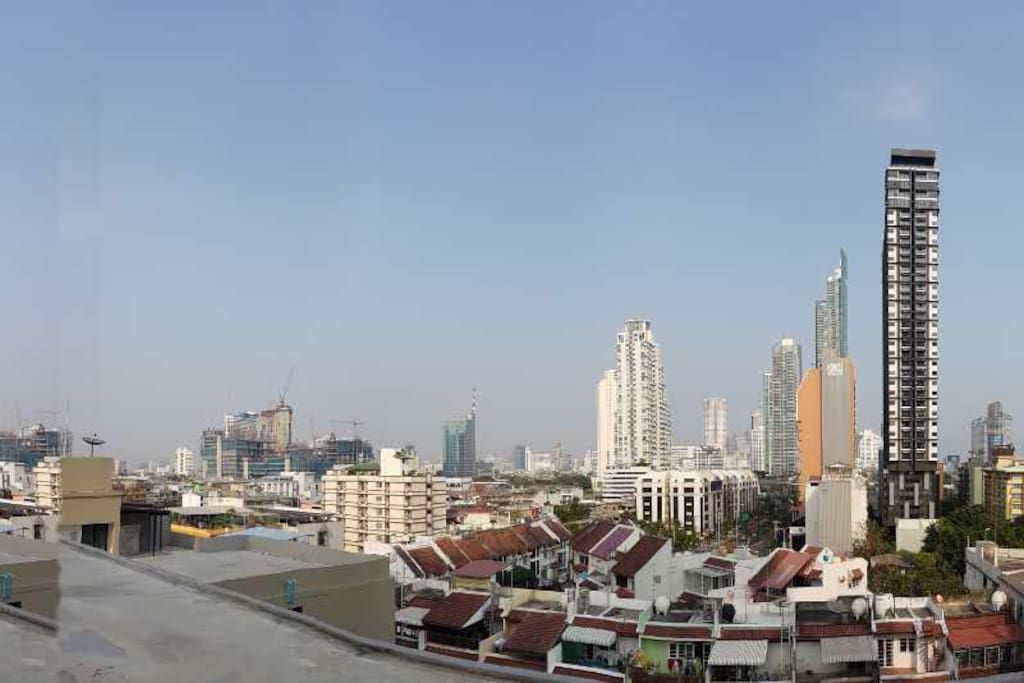 View from rooftop towards city. Tall gray/white building is where I live.
