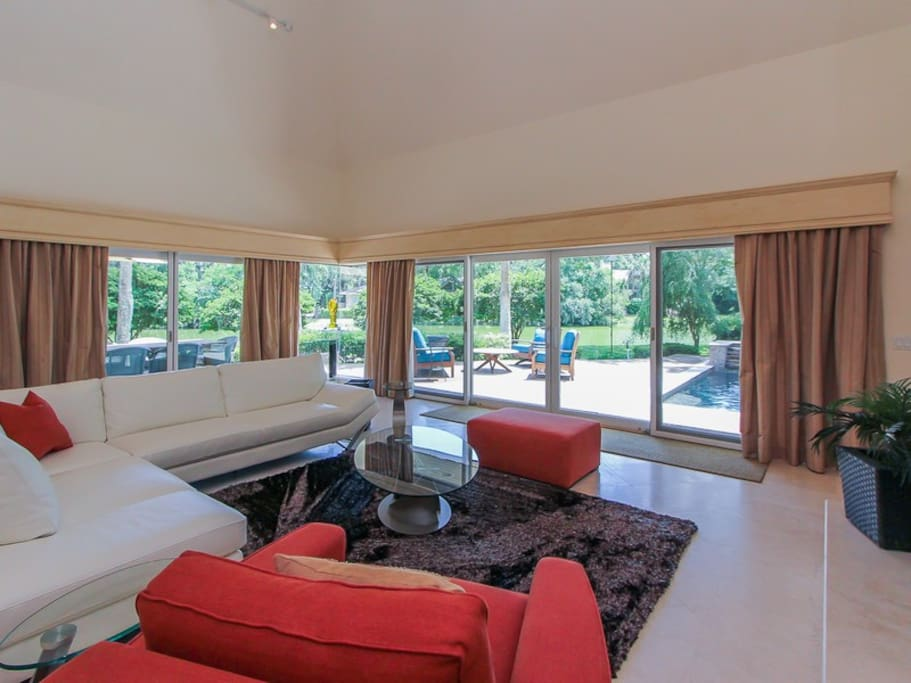 The open Living Area at 3 Marsh Island Road in Sea Pines offer beautiful views of the pool and lagoon