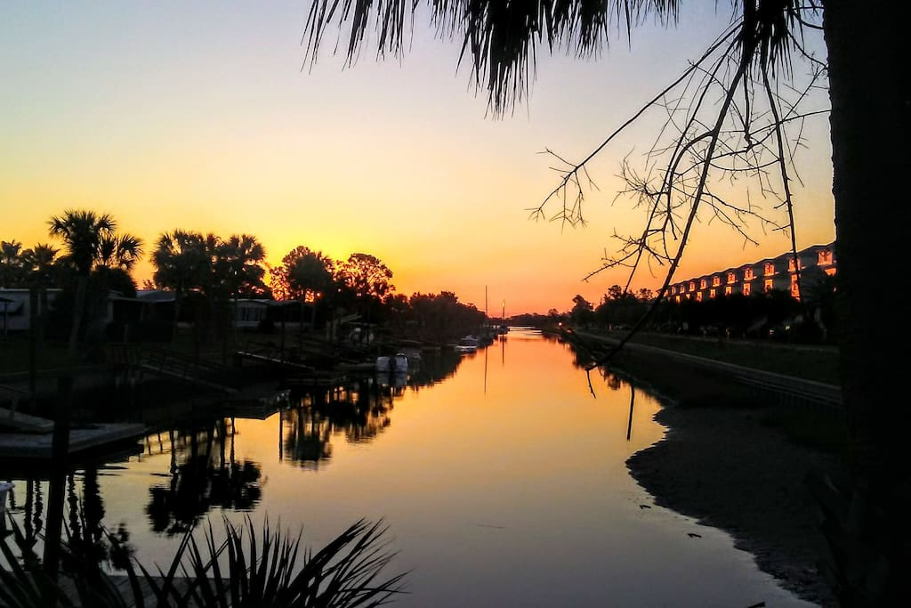 Sunrise from your private floating dock where sailboats bob in the kiss of the Gulf Breeze.