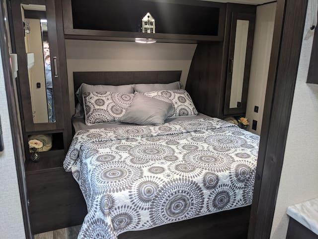 Queen bed with memory foam.