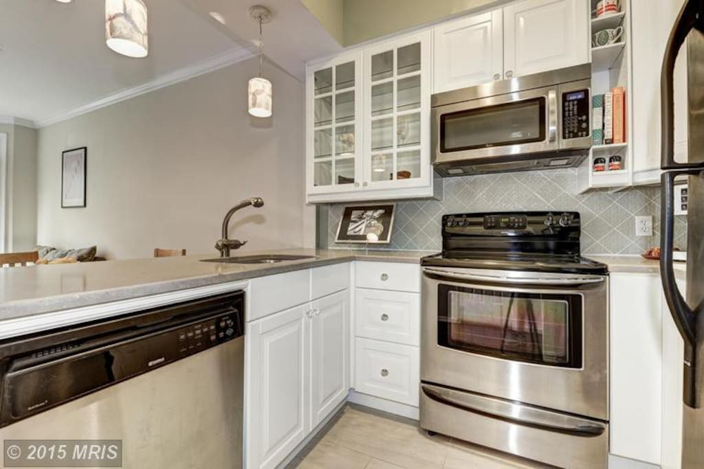 Kitchen - stainless steel appliances, dishwasher, stone countertop, high-end fixtures