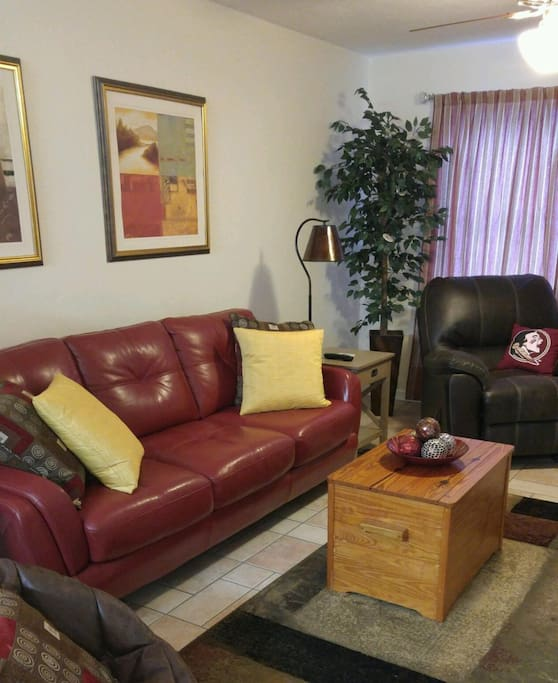 Leather sofa and recliner and 42 inch TV.