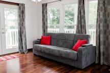 The sleeper sofa on the main floor (in sofa position)
