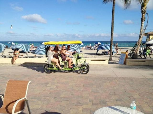 Hollywood Beach Boardwalk where you may take your family for a long walk along the beach and enjoy restaurants, bars and the night life. Only 9 minutes away by car, you may Uber to and from and forget about driving!