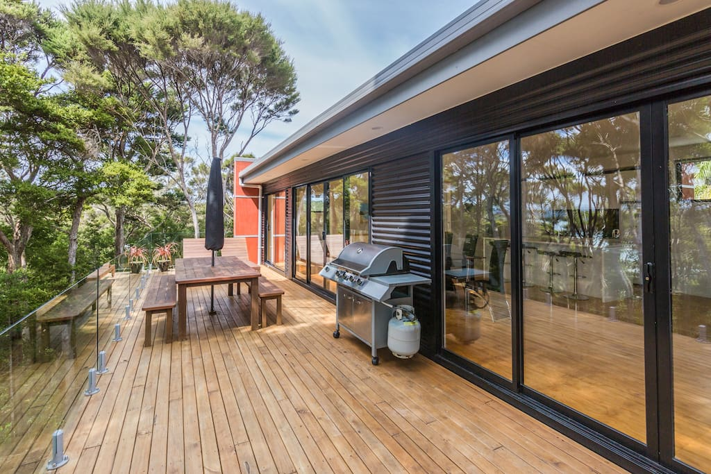 Deck, BBQ, Outdoor dining, over looking the bay/beach, through native forest.