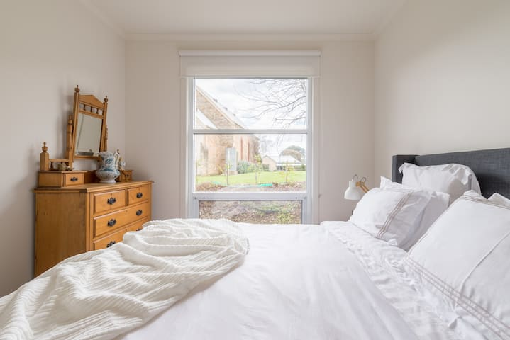 Your sleeping space,  queen bed with memory foam topper, electric blanket. Hanging and drawer space.  The view is  of an old unused  Hahndorf Church - local heritage.