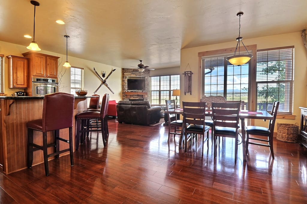 Open entertainers floorplan with hardwood floors and sweeping views of preserve.
