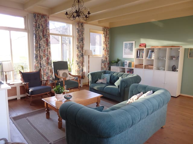 Large living room with tv, radio/cd-player, childrens books, information and books about the area and a nice view over the fields