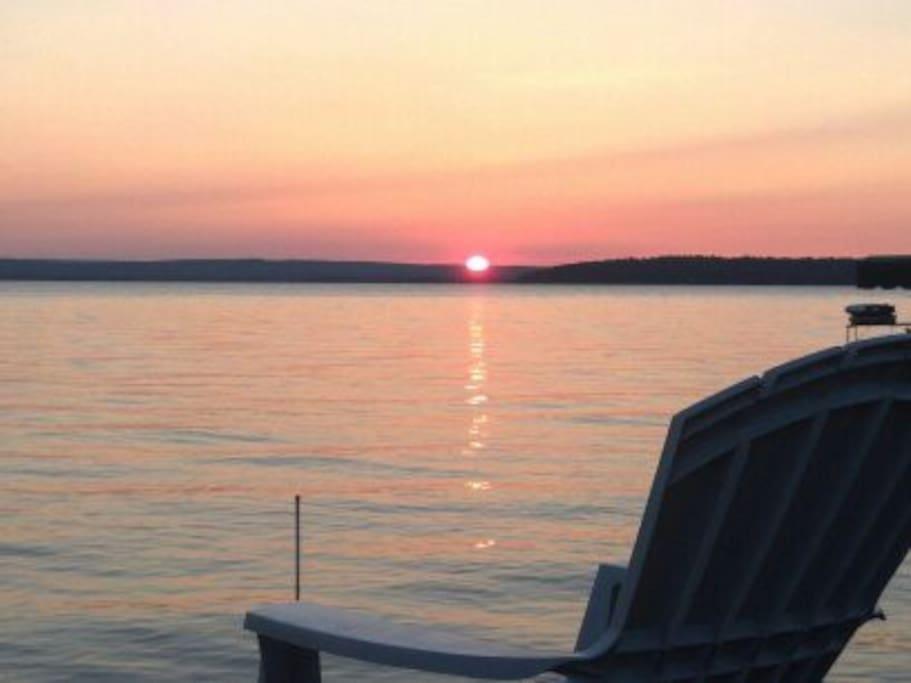 Sunset over Burt Lake from sundeck on dock