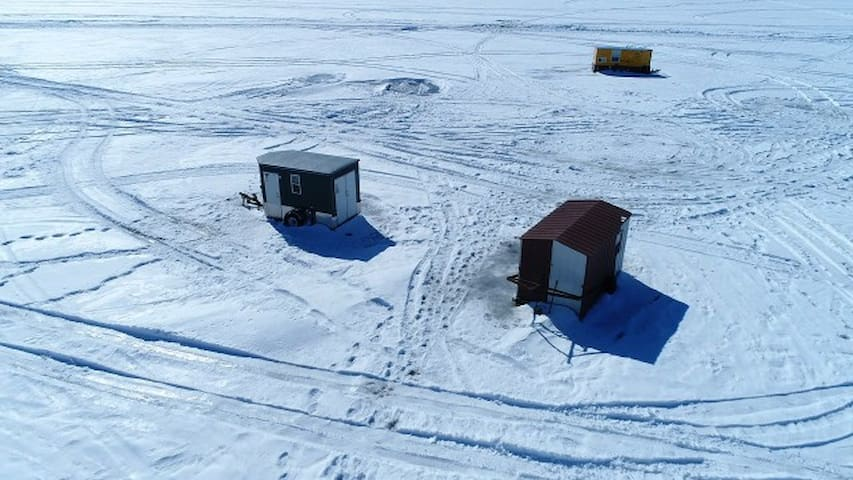 Ice fishing on Briggs Lake Chain.  Some of the best fishing on the lakes is a couple of hundred yards from our shore.