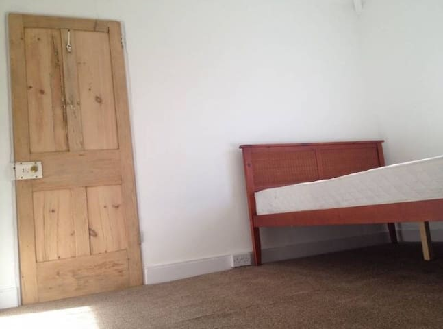 Bright and airy room in a quiet street near town