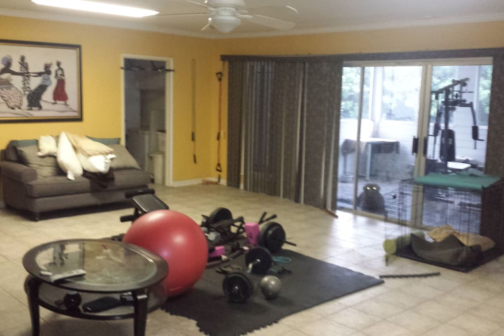 """Family room with workout equipment and 55"""" tv with cable."""