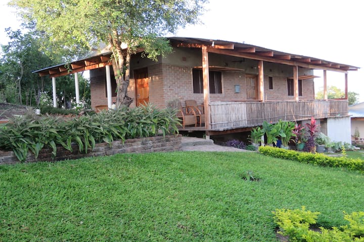 Sunrise Cottage has two bedrooms, shared toilet and shower and small kitchen area and verandah