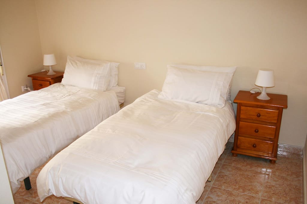 Twin bedroom on 1st floor with fitted wardrobes. Air conditioning and ceiling fan.