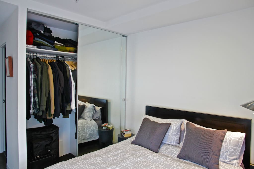 comfortable and clean double bed with spacious wardrobe closet
