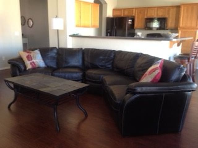 Open concept kitchen overlooks the living room - couch seats 4-6, lazy boy recliner is great for reading or watching TV