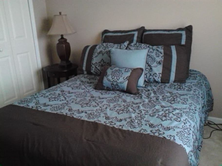 Private bedroom with full sized bed, comfortator set changes with season