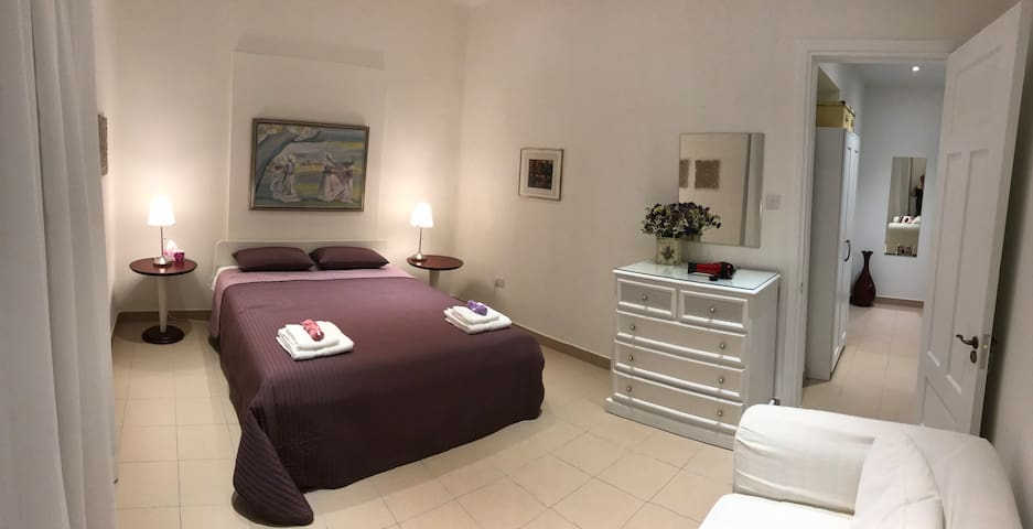"""""""Olive Apartment"""" bedroom wide angle view"""