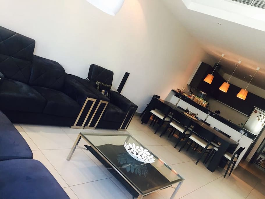 Living Room: Sofa Set with 8 Seater dining table and T.V with Music System.