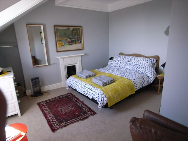 Top floor double bedroom with ensuite WC, shower and sofa. View of York Minster/Cathedral and local area