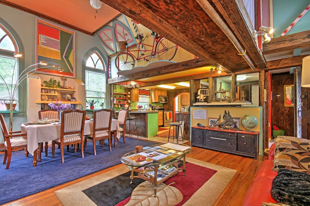 Step inside the vibrant, open-concept living space, filled with original art and colorful furnishings.