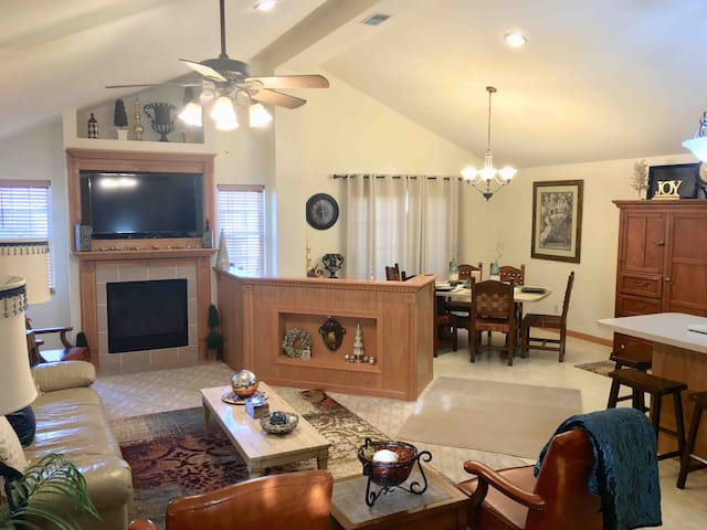 Vaulted ceilings, open concept to kitchen and dining area. Flip switch to gas fireplace