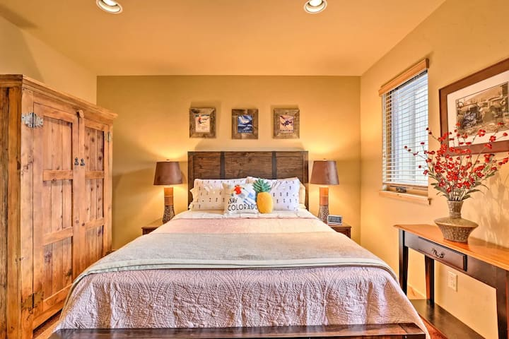 Queen size bed with down comforter and classy sheets