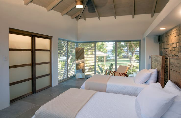The twin bedroom with full length louvre windows