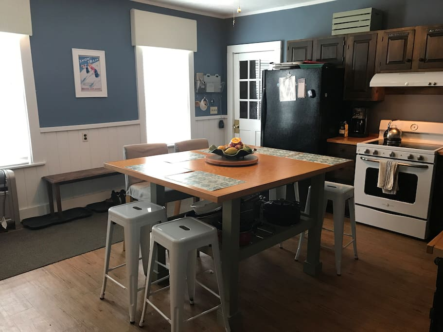 Large eat in kitchen with oversized island that seats 6-8 people. Oversized refrigerator, double sink, dishwasher, new range.
