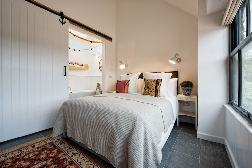 King size bed and bathroom