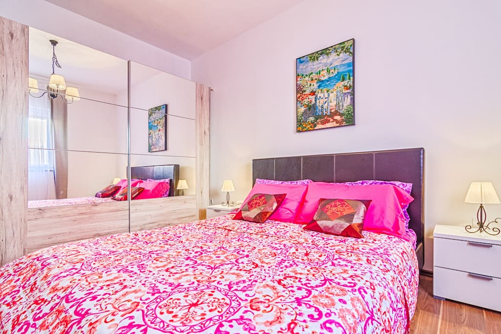 Bedroom with double size bed and big wardrobe