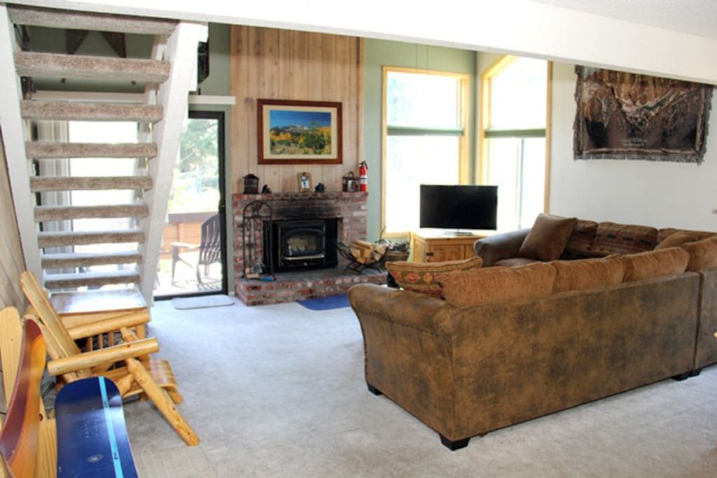 Mammoth Lakes Condo Rental Wildflower 2 - Living Room with Woodstove and Flat Screen TV