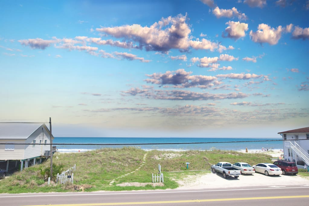 The land across S. Fletcher Ave. is owned by the property so guests enjoy private beach access  Amelia's Retreat