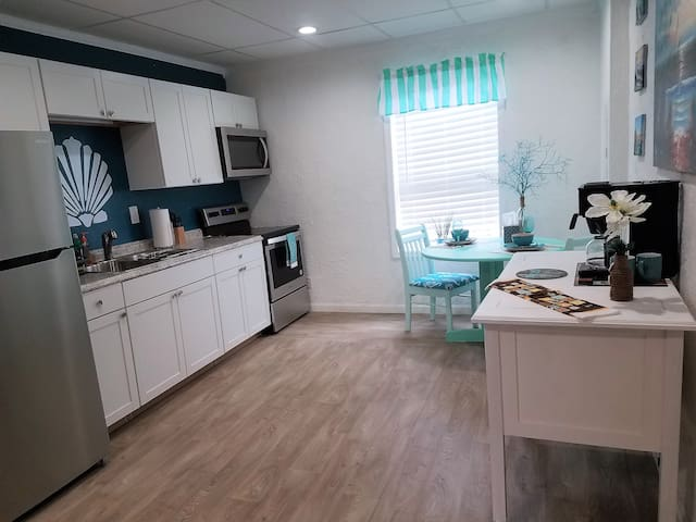 Kitchen, dining table and coffee station