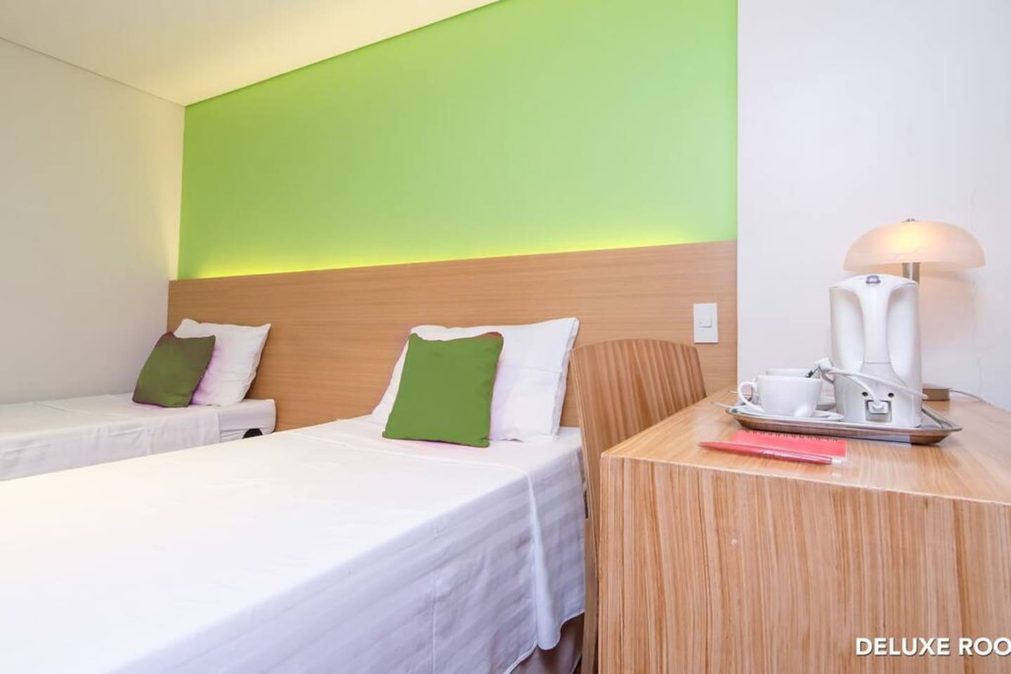 Interior of DeLuxe Twin bedroom at MySpace Hotel @BGC with electric kettle, lamp shade and desk.