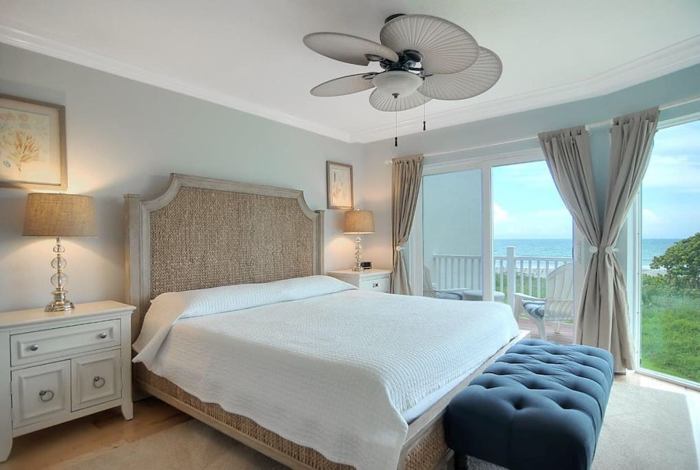 master suite with balcony and ocean views